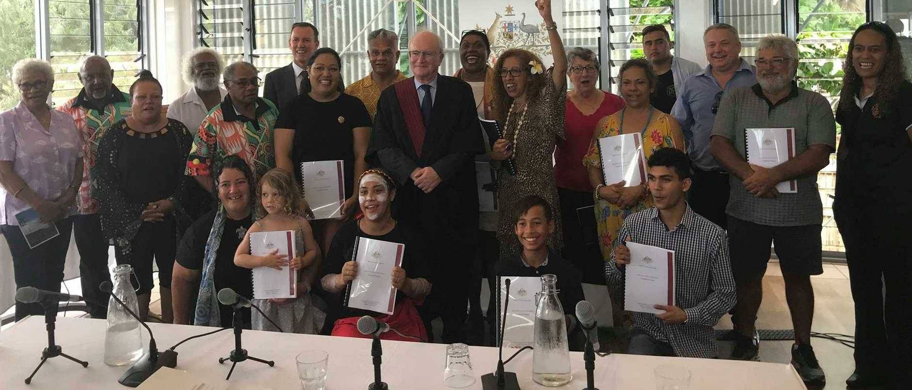 Justice Alan Robertson with the recipients of the native land title claim.