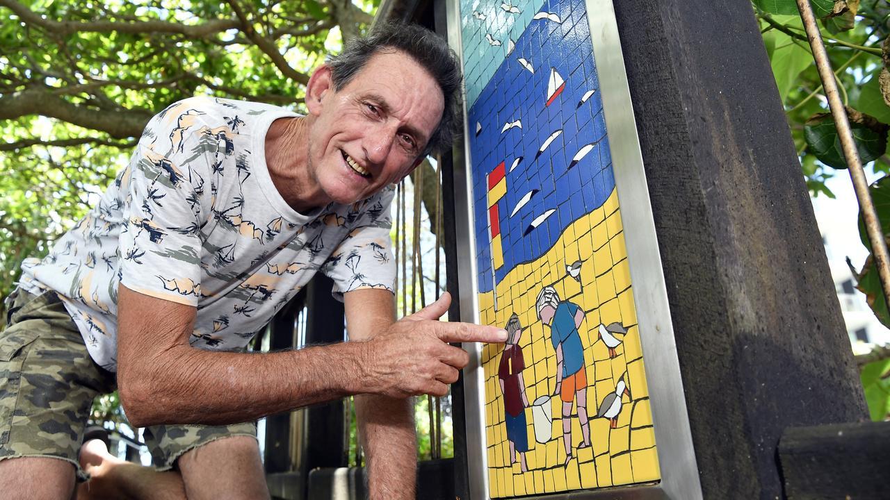 Coolum HeARTs mosaic class facilitator Les Kirkbride shows off his artwork along the Coolum boardwalk. Photo: Patrick Woods.