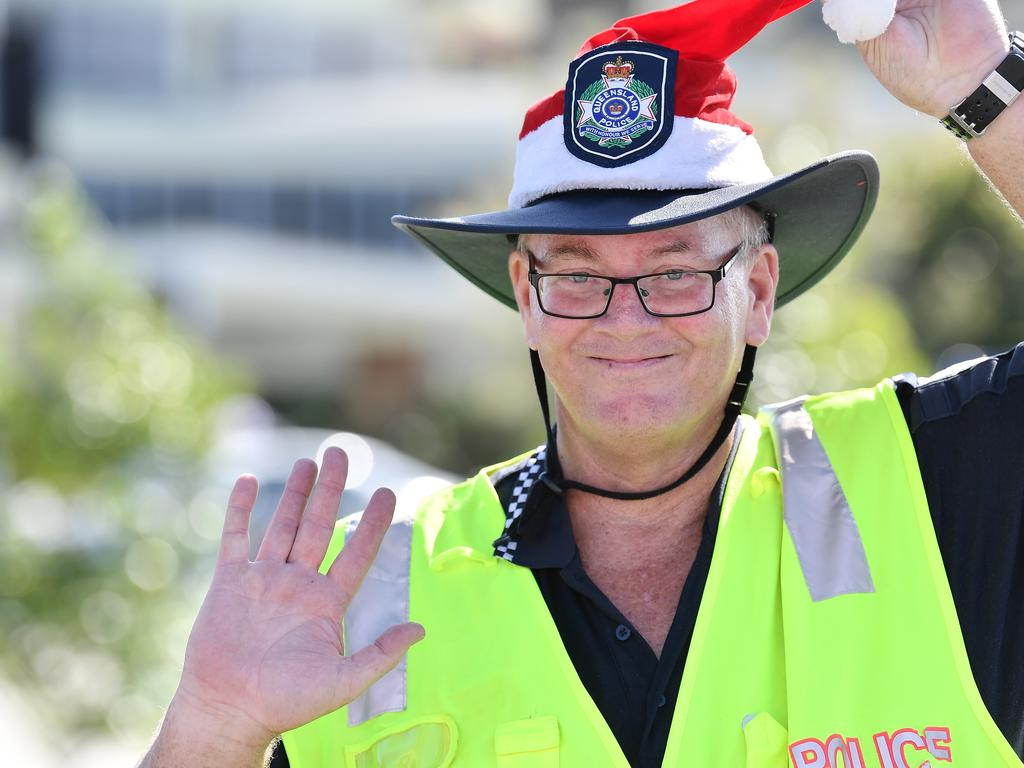 Hot under the vest Police Santa Topher McLoughlin directing traffic at the Sunshine Plaza. Picture: Patrick Woods.