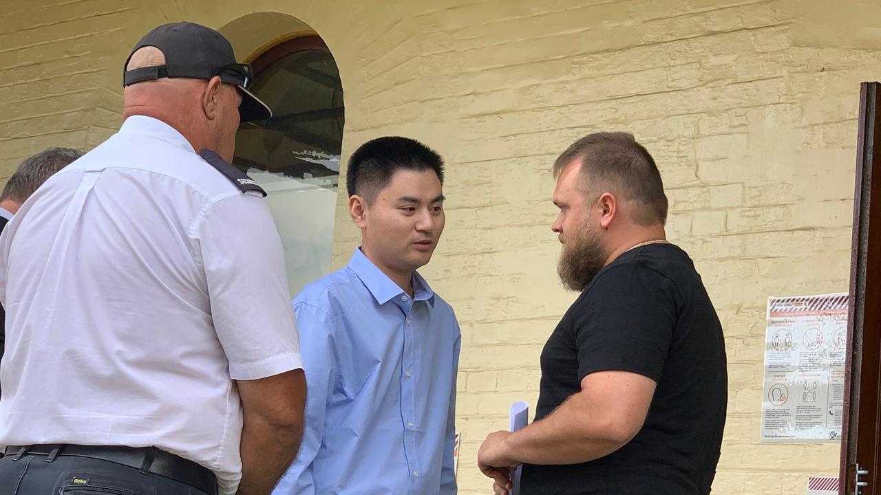 Xi Ling, left, apologises to Tim Kay, son of crach victin Rhonda Kay, outside Maryborough Magistrates Court.