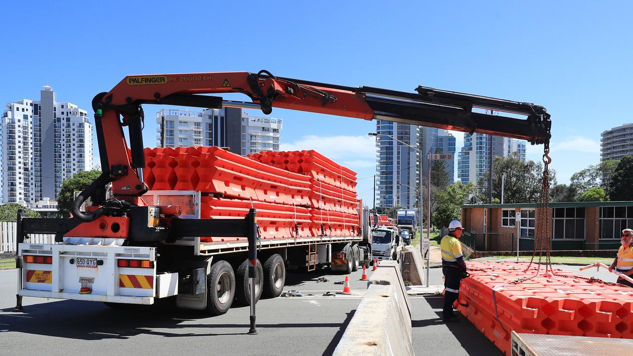 Police and Council workers yesterday installed large plastic retaining barriers blocking entry into Queensland from NSW through Tweed Heads after QLD closed its borders to Sydney residents due to other major Covid breakout. Photo: Scott Powick.