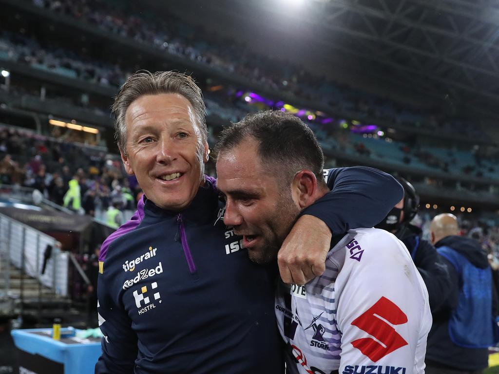 Melbourne coach Craig Bellamy celebrates with Cameron Smith.