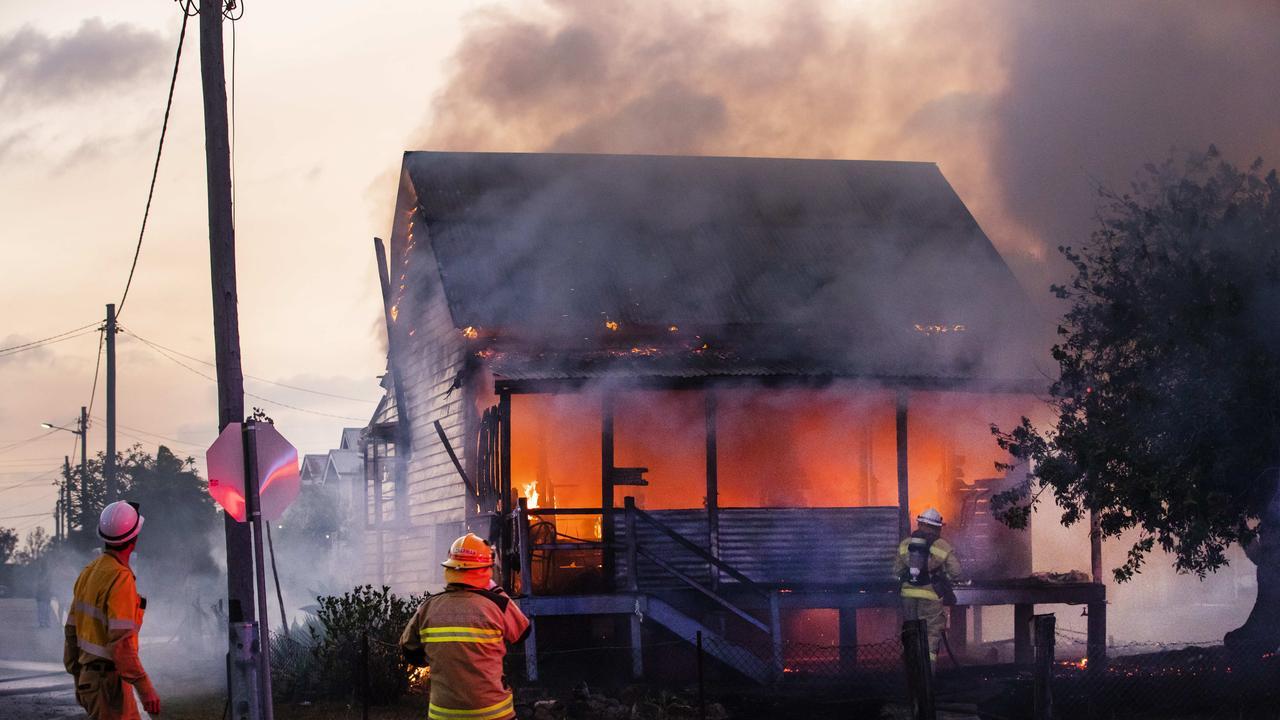Firefighters fight a wild house blaze on Alice Street at Maryborough. Photo Lachie Millard