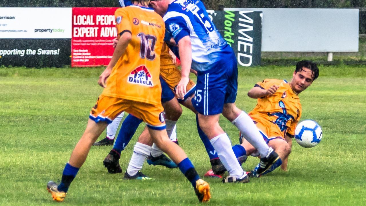 Goannas Matt Alberts in a slide tackle