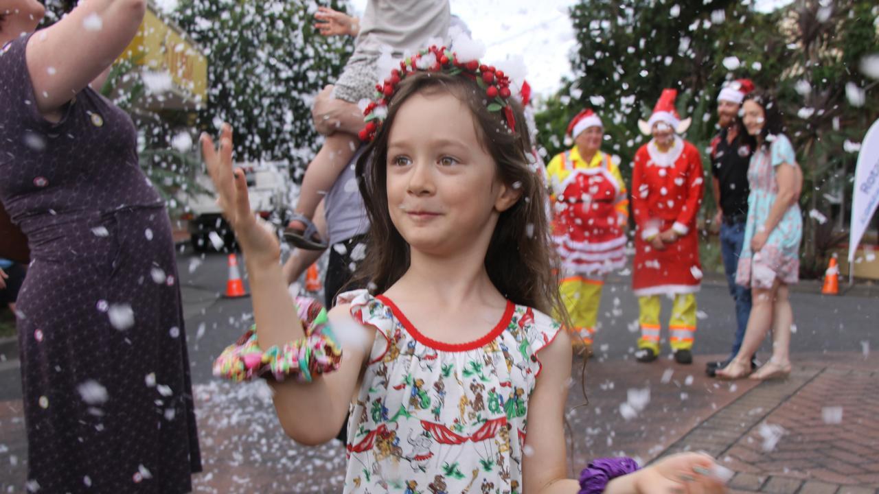 WHITE CHRISTMAS: Lola was one of the dozens of children who enjoyed the snow fun at Lismore's Carrington St on Christmas Eve. Photo: Alison Paterson