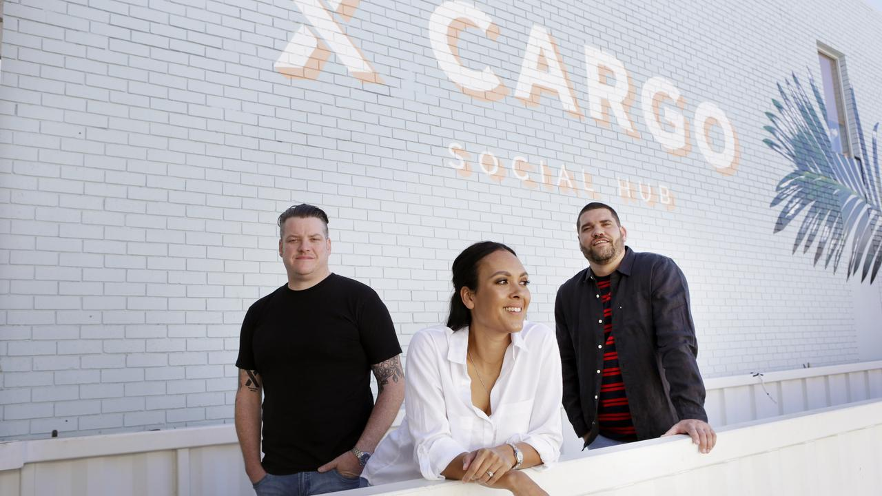 L-R Angus Cattanach, Leah Cattanach and Aydan Sturgess at XCargo in happier times after opening in July 2018. (Photo AAP/Megan Slade)