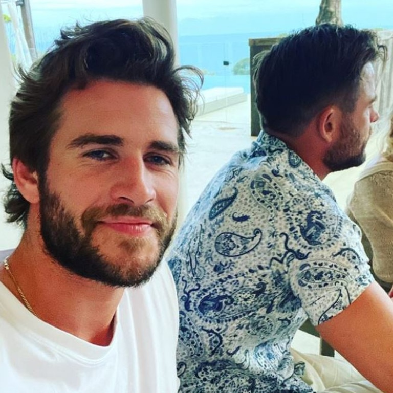 Liam Hemsworth. 30, taking a Christmas selfie with his brother Chris, who is clearly not interested in the photo. Picture: Instagram/LiamHemsworth