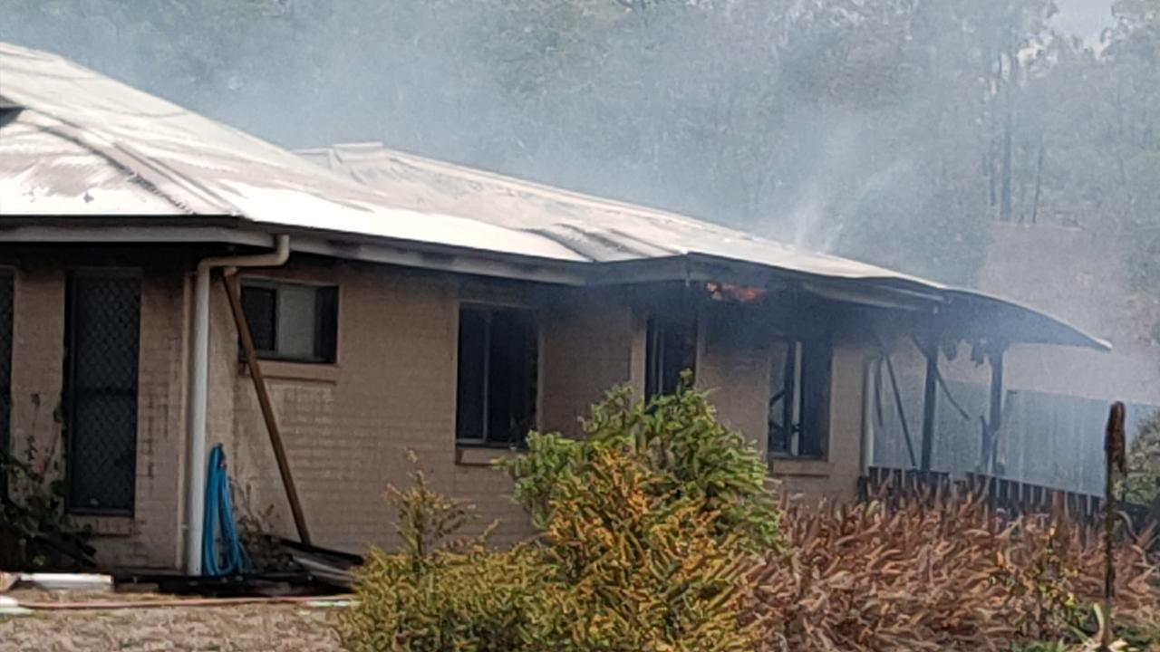 Flames could be seen licking at the eaves of a Calliope home on Sybil Court that was destroyed by fire on Boxing Day. Picture: Rodney Stevens