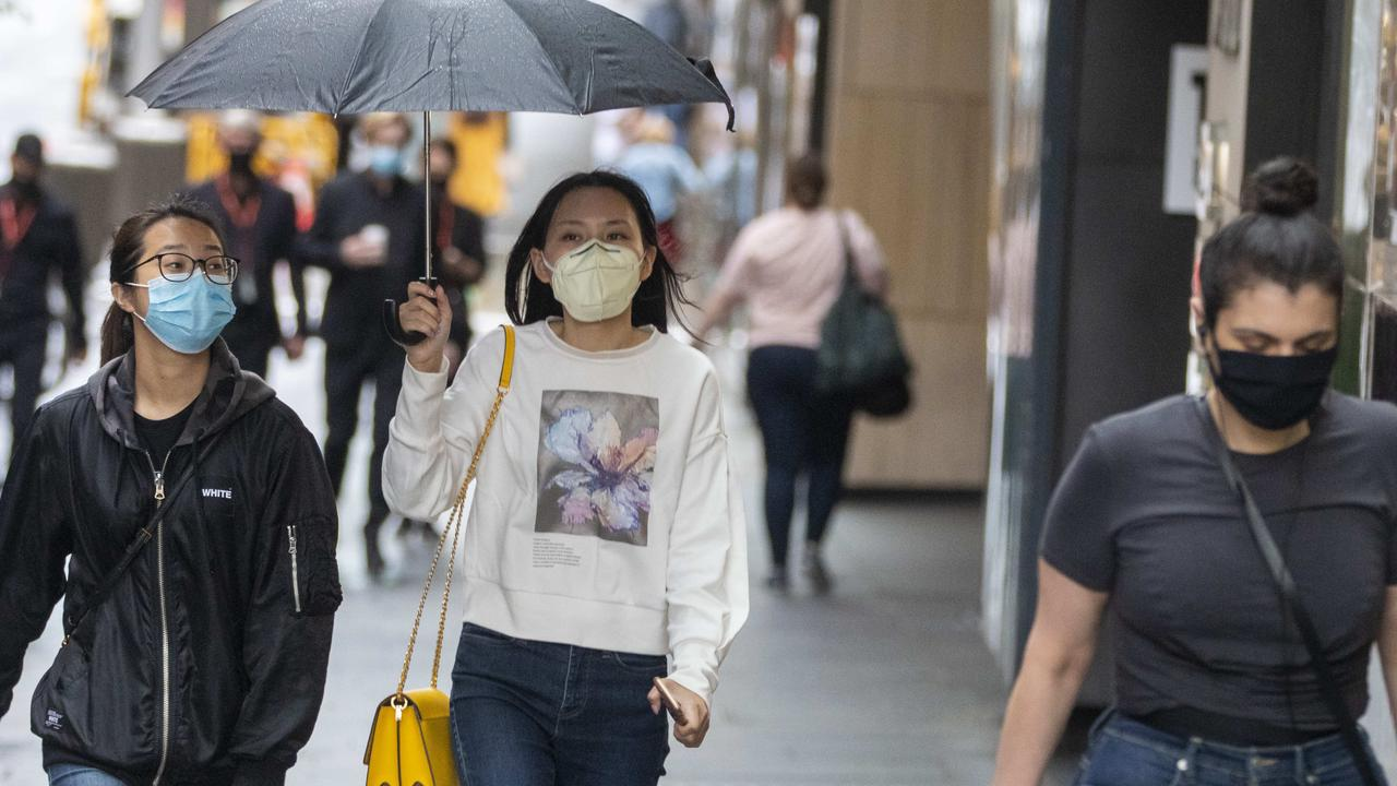 Sydneysiders braved the weather and coronavirus for Boxing Day sales shopping, despite pleas for residents to stay home this year. Picture: NCA NewsWire / Jenny Evans