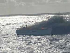 Boatie rescues family from burning vessel