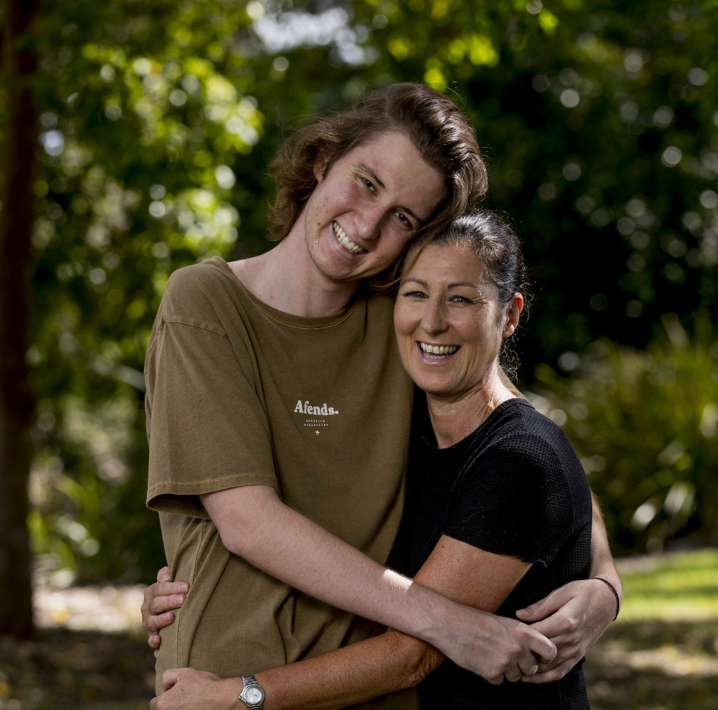 Elliott, 22, with his mother, Julie Cox in February 2020 before his double lung transplant. Picture: Jerad Williams