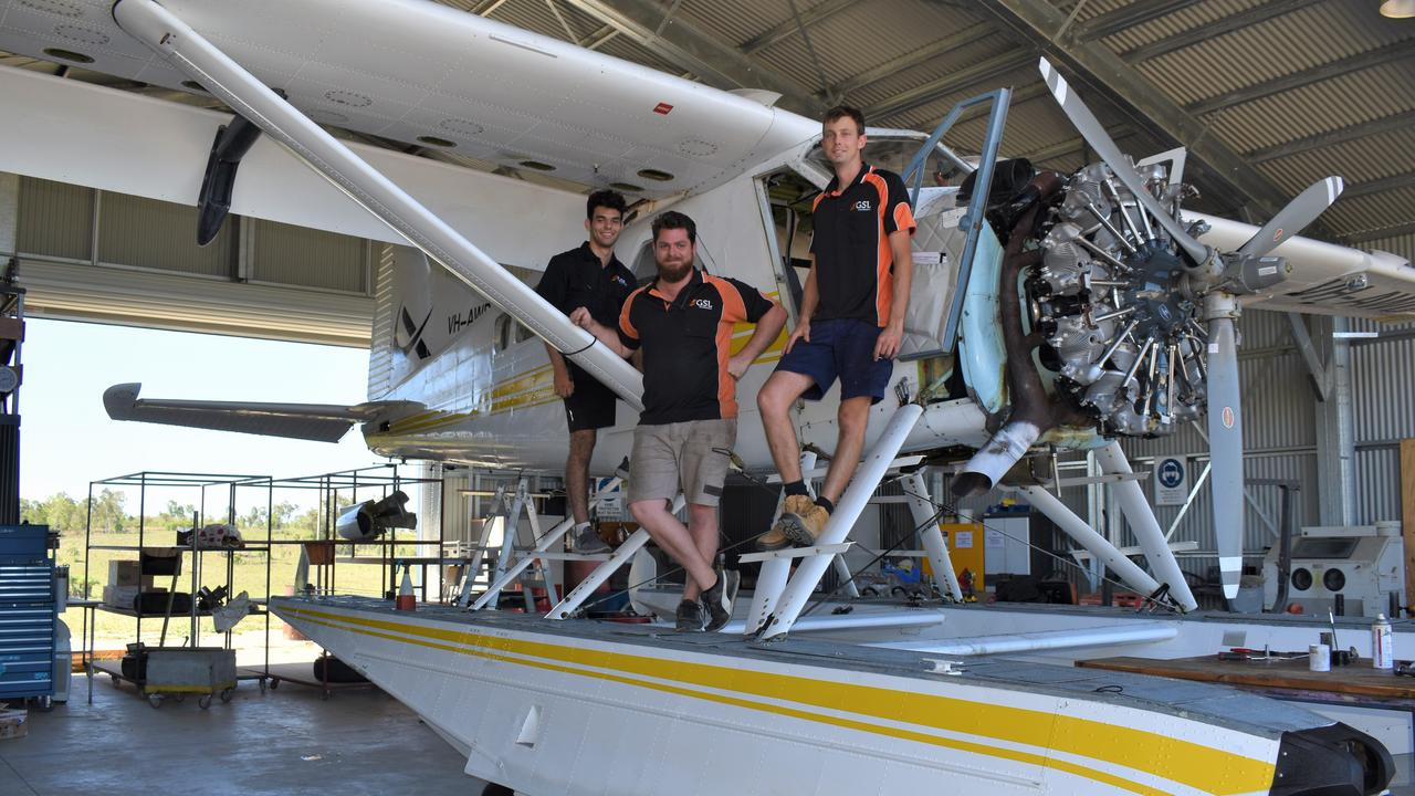 GSL Aviation chief maintenance engineer Matt Harding (centre) with first year apprentice Theodore Brown (right) and fourth year apprentice Cal Taylor (right) standing in front of a 1950s seaplane at their hangar at Lakeside Airfield, Bloomsbury. Picture: Heidi Petith