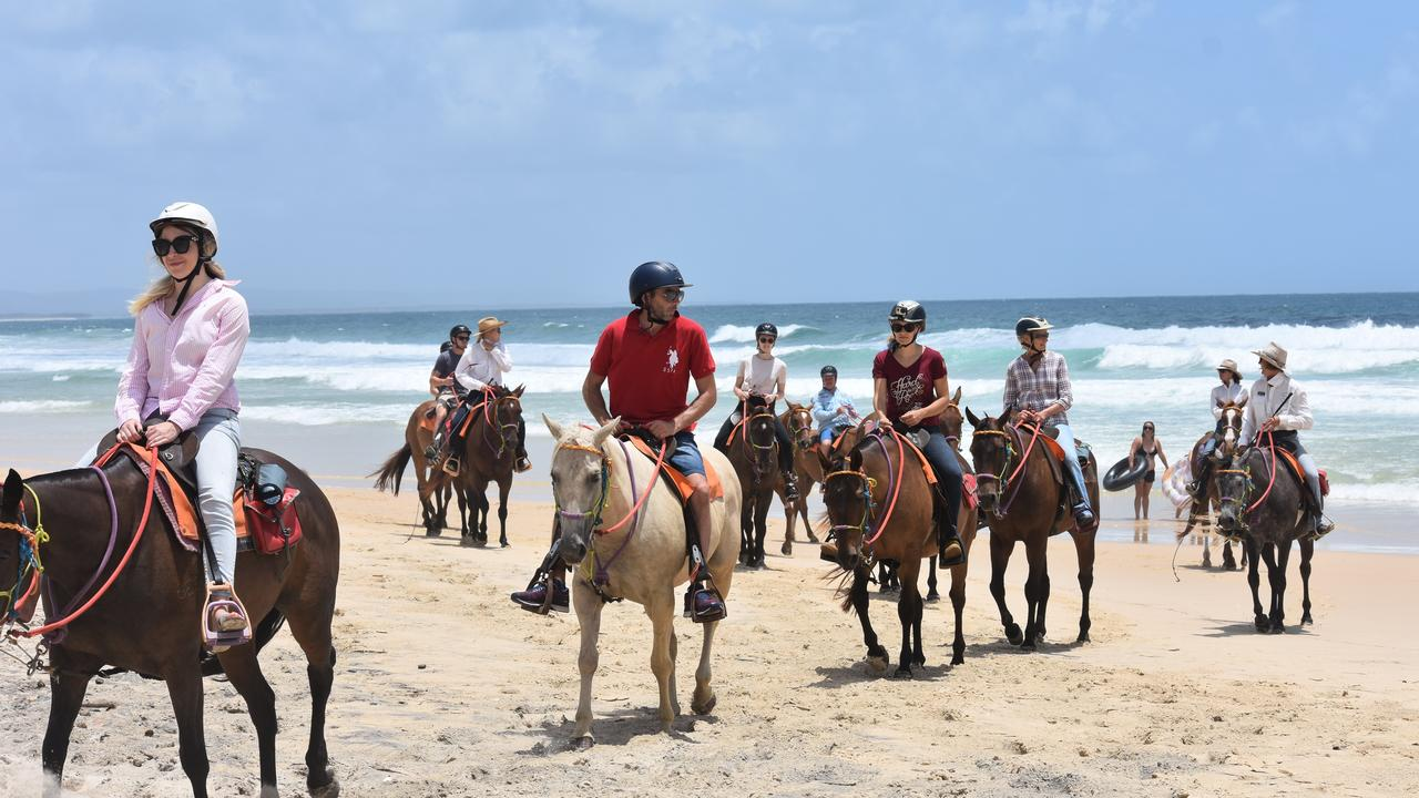 Another great beach ride as these visitors approach the end of their Rainbow Beach Horse Rides tour. Picture: File