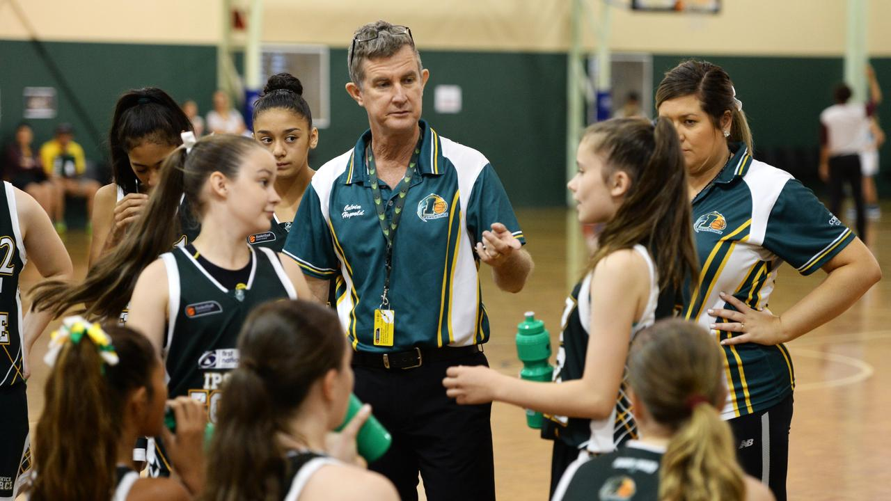 Ipswich Force coach Calvin Hegvold working with his successful under-14 team at the state titles. Photo: Rob Williams
