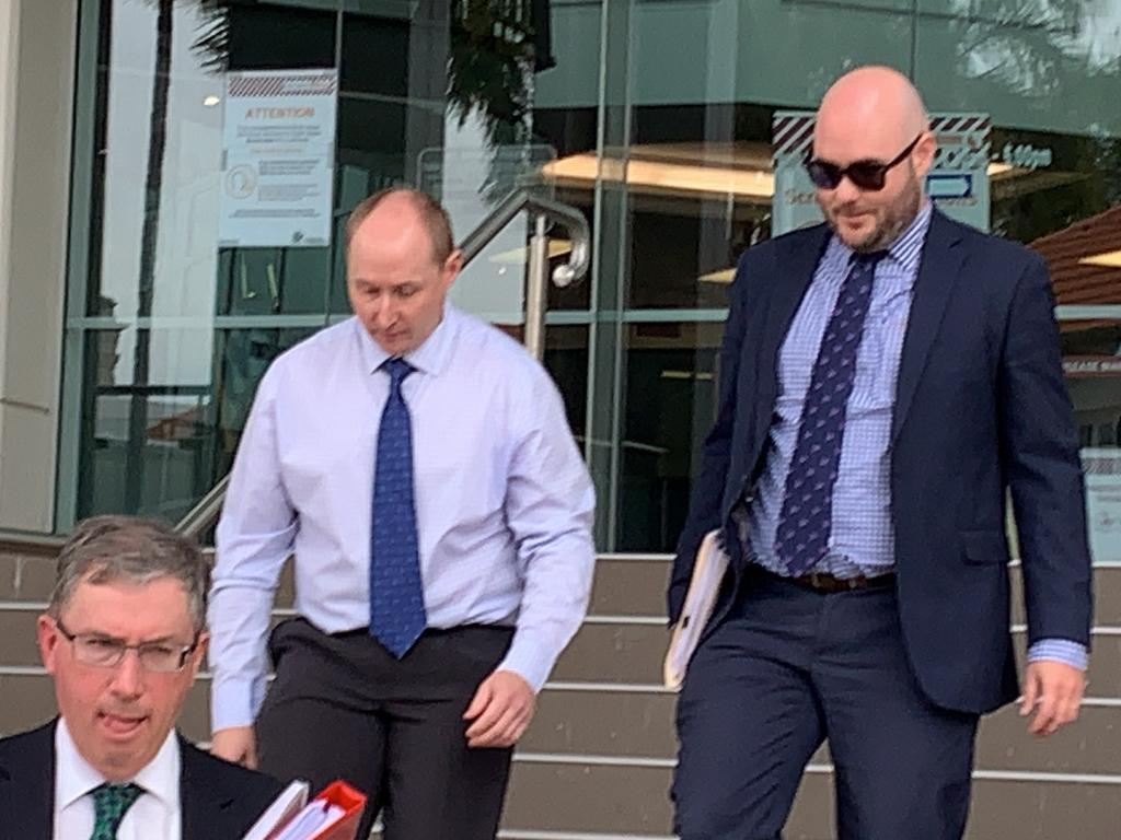 Former high school teacher Nathan Neil Ramm, 39, leaves Rockhampton court house after being sentenced to 18 months prison, wholly suspended and operational for three years, along with 18 months probation for charges of distributing and possessing child porn. Pictured with Ramm is his barrister Michael Copley (left) and solicitor Grant Cagney.