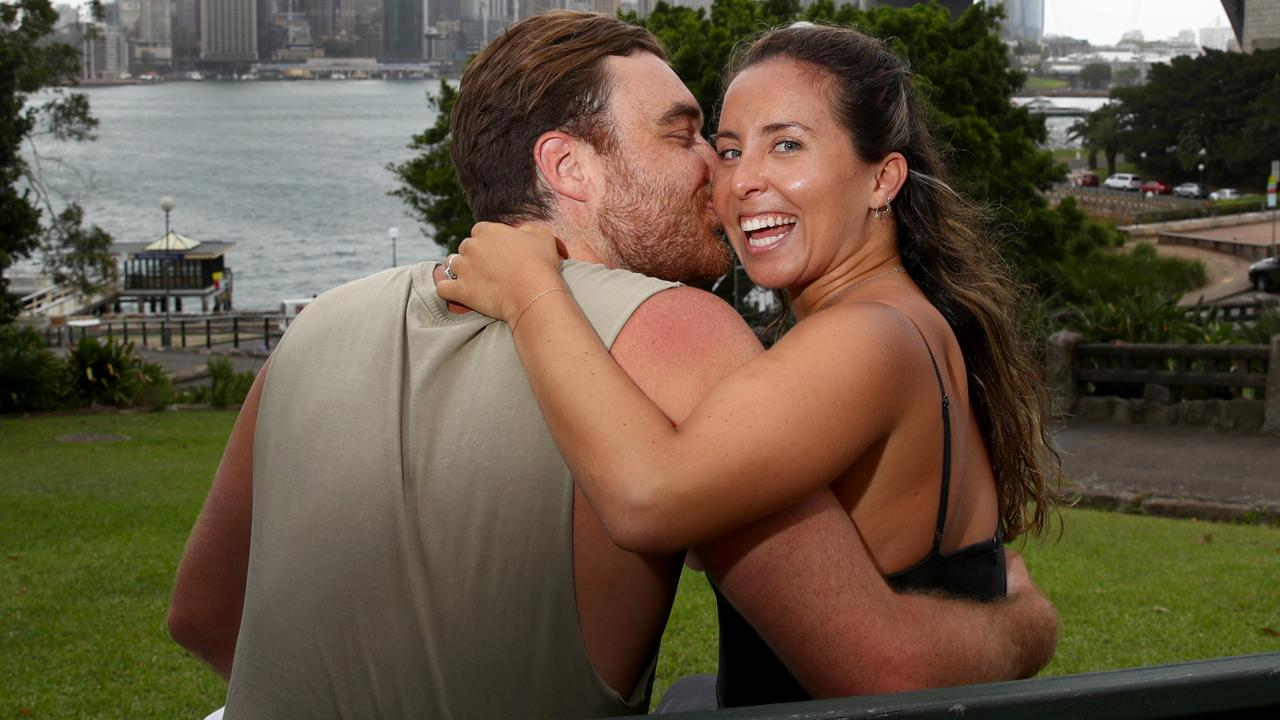 Couple Ed Cameron and Stefania Schiller enjoy the view from Kirribilli before the area will be closed to the public on NYE. Picture: Toby Zerna