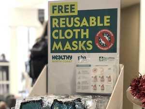 Free reusable masks given away at tourism hubs