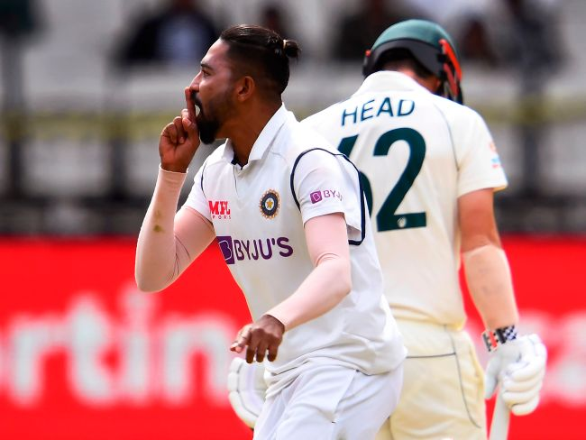 India's Mohammed Siraj (L) celebrates the dismissal of Australia's Travis Head (R). Picture: AFP