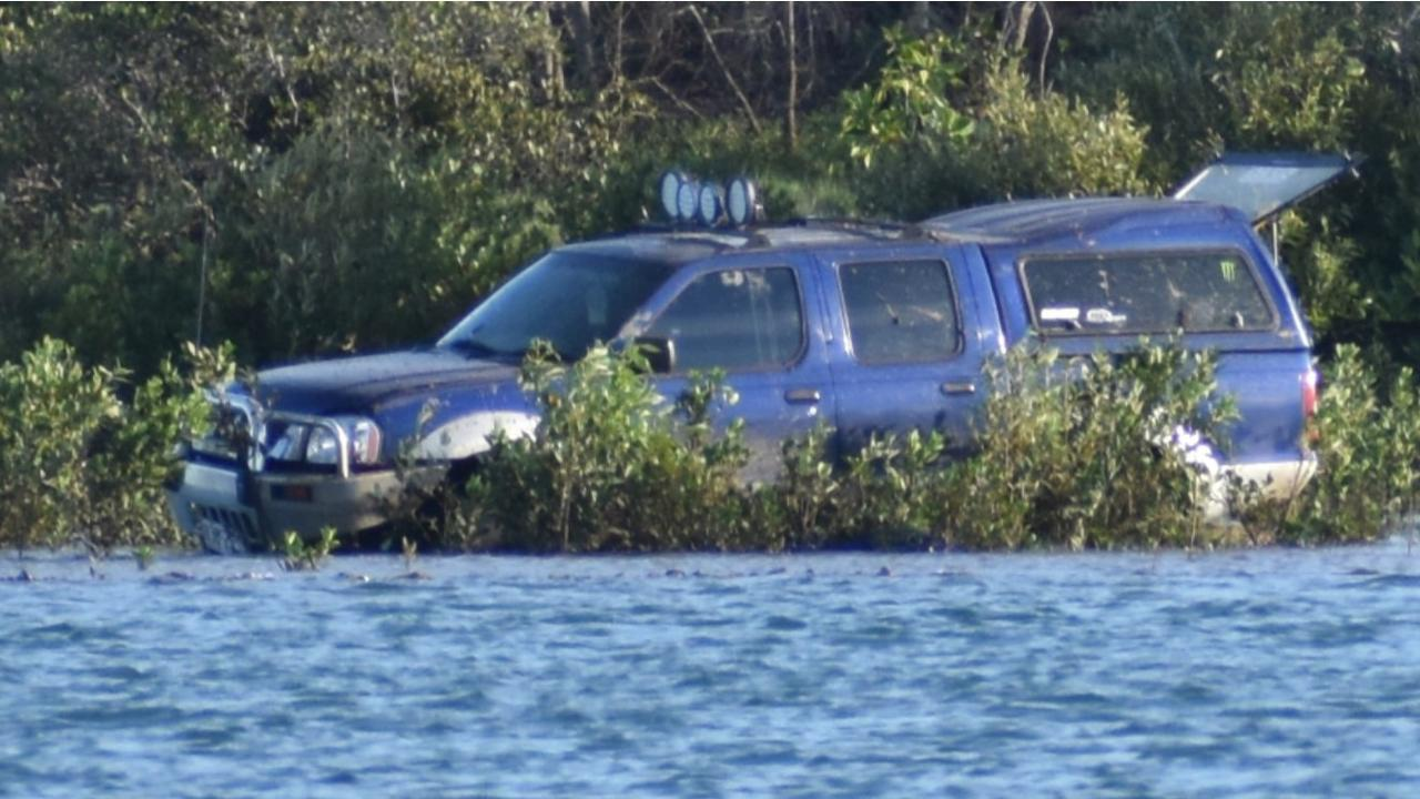 A vehicle seemingly abandoned in the Pioneer River, Mackay as high tide approaches on the afternoon of Tuesday, December 22, 2020. Picture: Heidi Petith