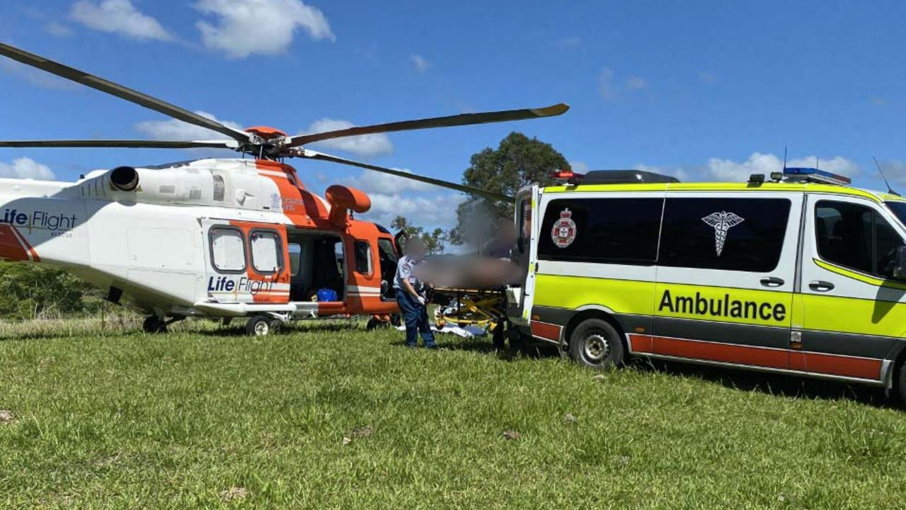 Paramedics prepare to airlift the man to Brisbane.