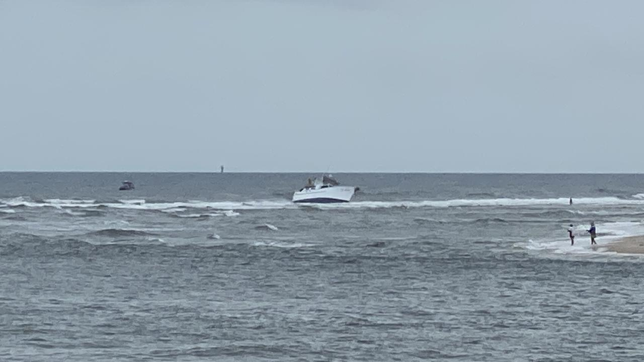 Water police and a rescue helicopter are conducting a search after a vessel ran aground at Caloundra with only a dog onboard.