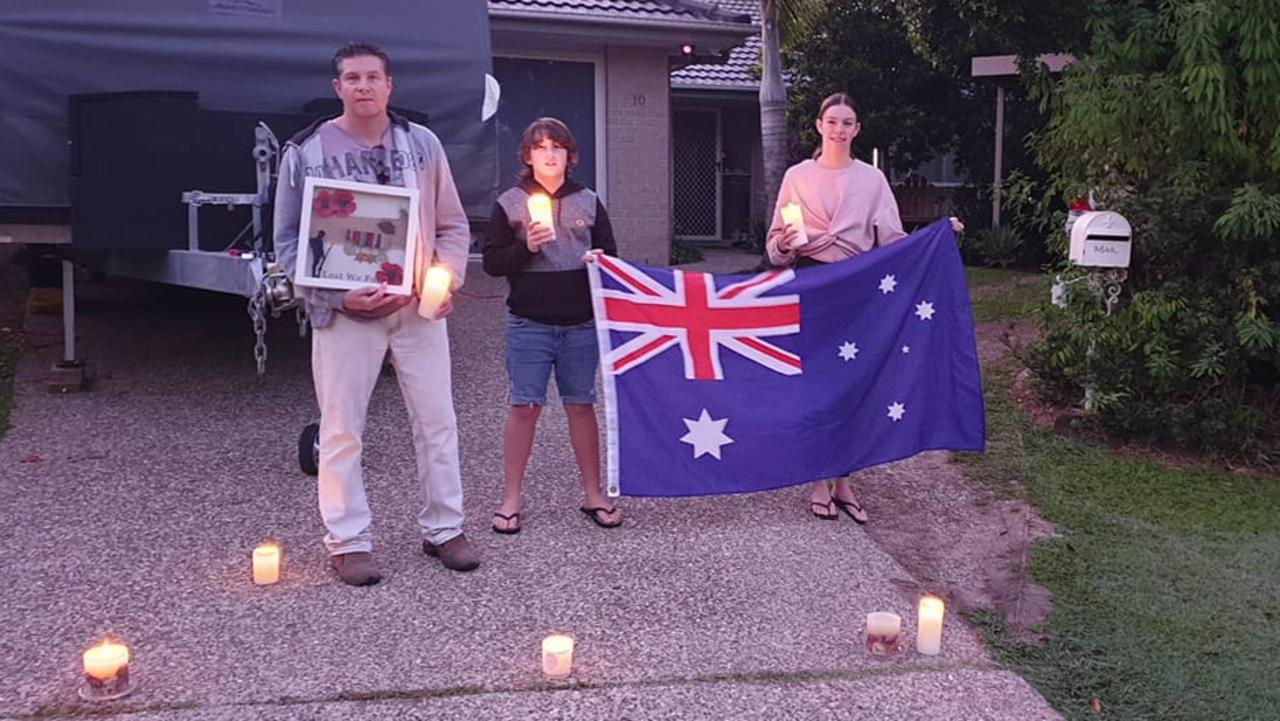 Michael, Savannah and Kai Betts commemorating Anzac Day 2020 from their driveway.