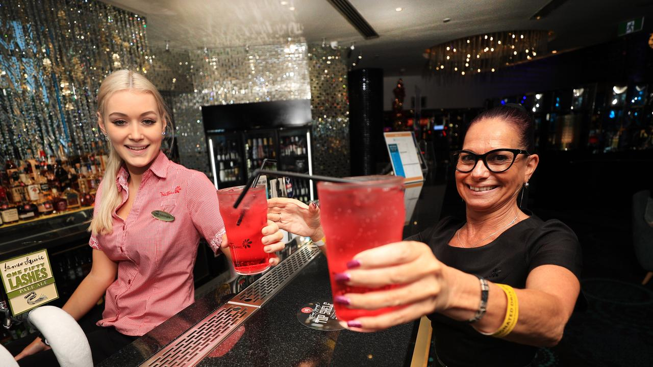 17th December 2020 – Bar Tender Georgia Gosling hands Miss Lina Putzolu as part of Twin Towns' annual designated driver campaign, allowing designated drivers get free post mix soft drink Photo: Scott Powick Newscorp