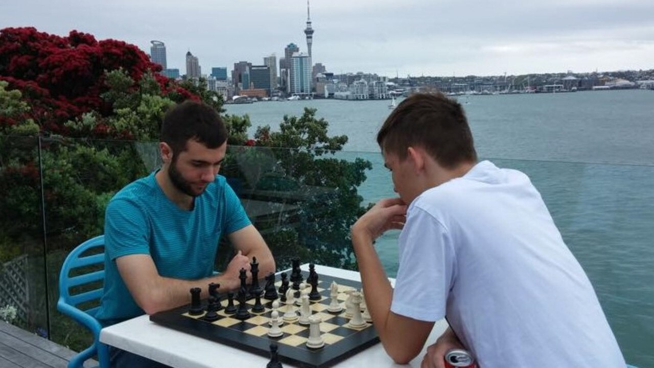 Justin Turner (left) playing his first chess tournament in New Zealand in 2014.