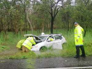 Car abandoned after skidding off Bruce Highway