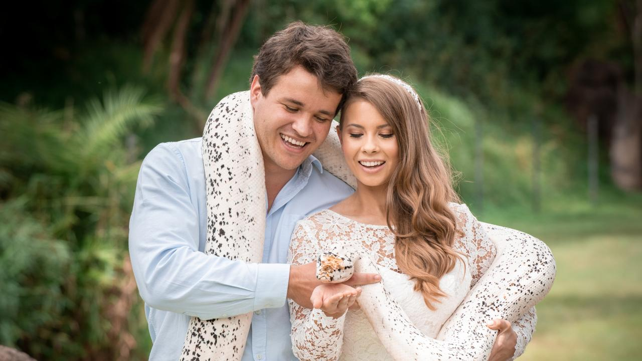 Chandler Powell and Bindi Irwin on their wedding day with a python Picture KATE BERRY