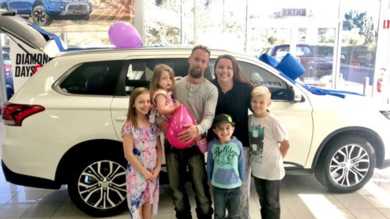 Kerry and DeAnne Pokarier in front of their family car with their four children. Picture: Online/GoFundMe.