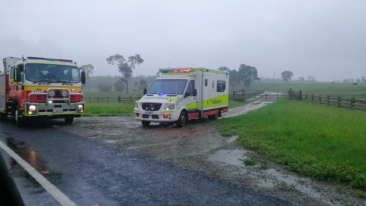 Queensland Fire and Emergency Services and Queensland Ambulance Services attended a crash on the Bruce Highway, at Ilbilbie after a car was abandoned in flood waters after skidding off the road on Wednesday December 30. Picture: Contributed