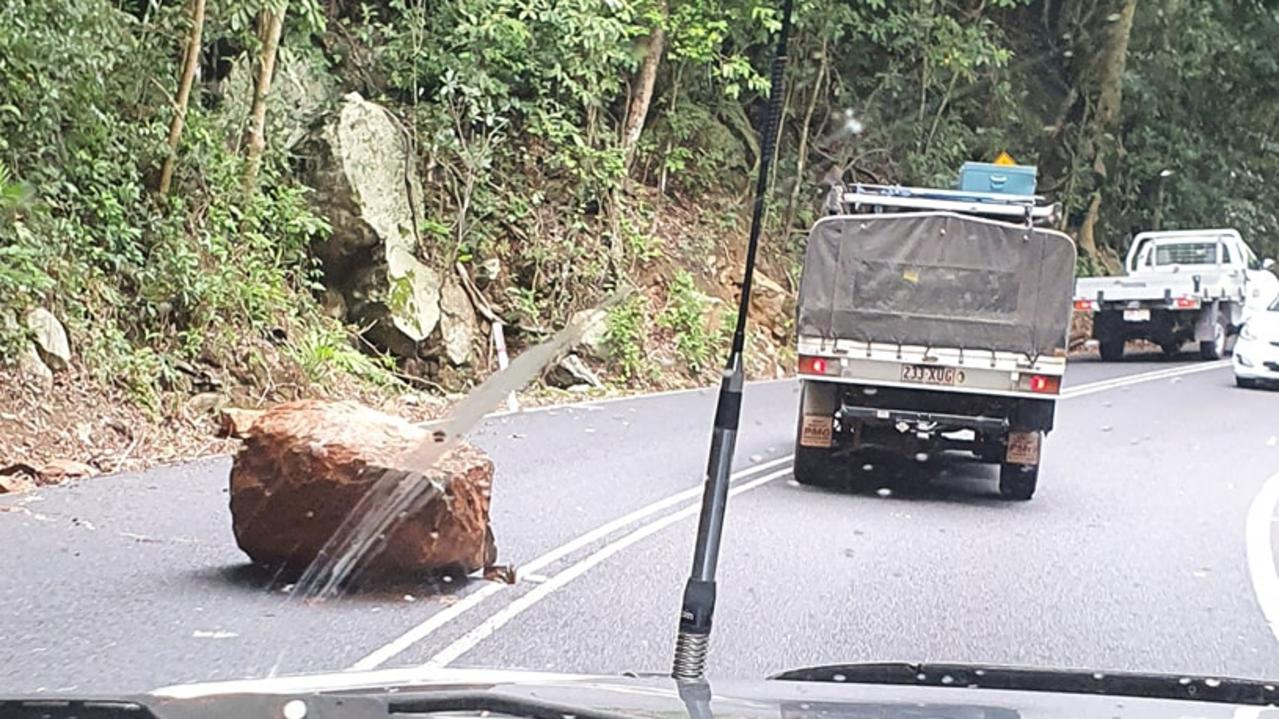 A woman has described the horror of watching a giant boulder land within millimetres of her car as she drove home. The road has now been cleared.