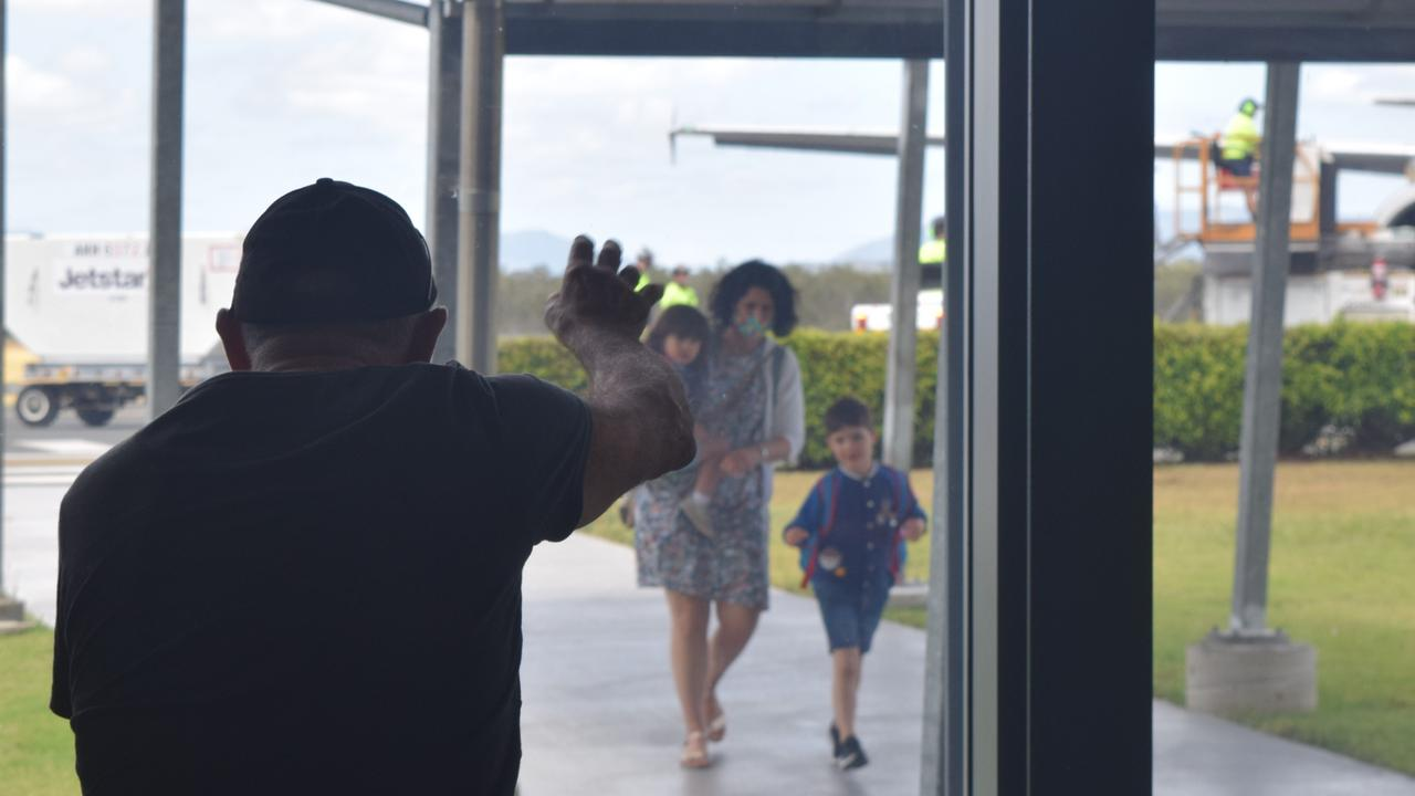 Louis Bezzina waves at his daughter Natalie and grandchildren Maribel and Marcello before they were reunited at Whitsunday Coast Airport today. Picture: Laura Thomas