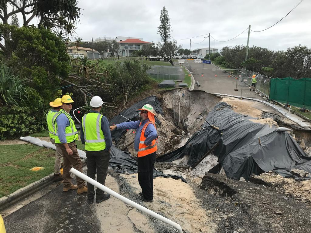 Noosa Council and Unitywater engineers inspect the damage after Tingira Crescent, Sunrise Beach collapsed for a second time causing extensive damage.