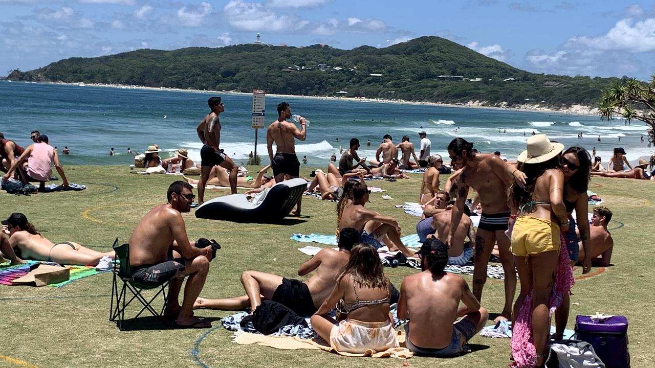 Thousands of tourists enjoyed the sunny weather at Byron Bay on December 31, 2020, and although Main Beach was closed, other beaches like The Wreck and parks were very popular.