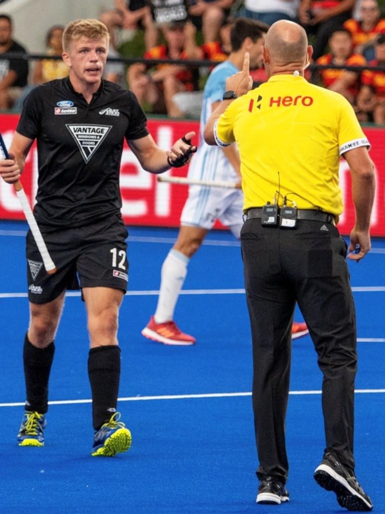 Ipswich international hockey umpire Steve Rogers controlling play during a Pro League match before COVID struck.