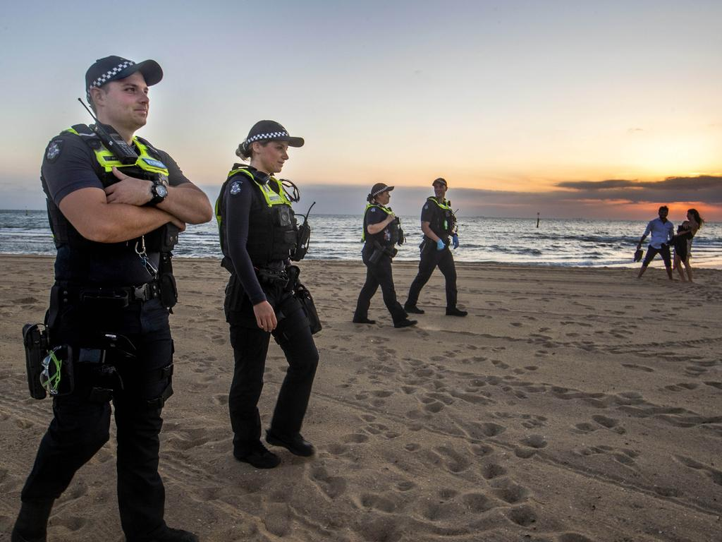 Police patrolling St Kilda beach on New Years eve. Picture: David Geraghty