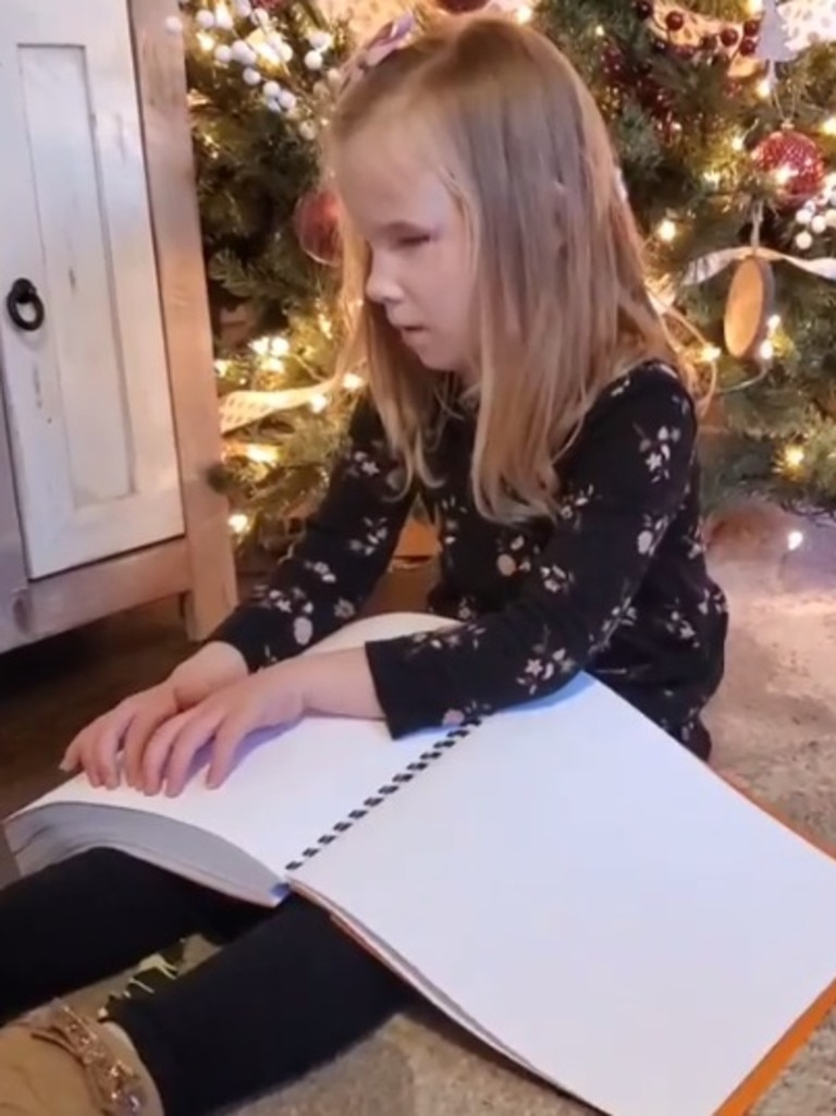 The seven-year-old had no idea what the books were when she opened her present.