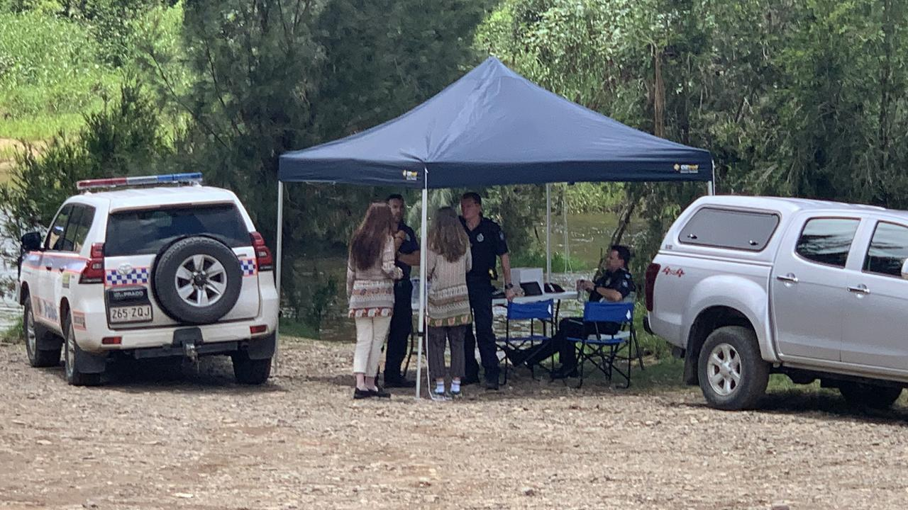 Police talks to campers at the grounds where the man vanished.