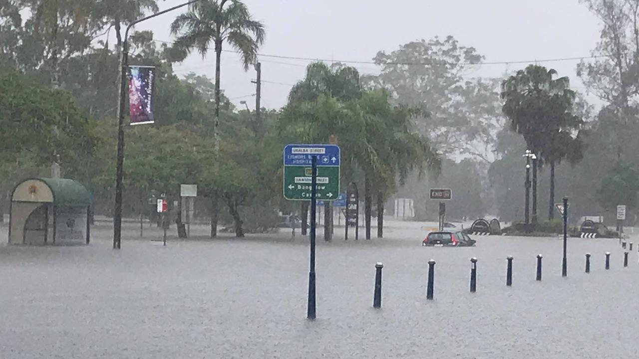 A driver was caught in flood water in Lismore CBD.