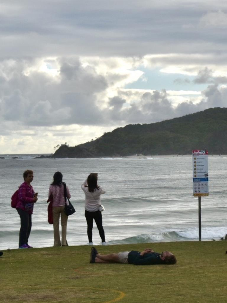 Tourists and residents at Byron Bay's Main Beach at 7am on January 1, 2021.