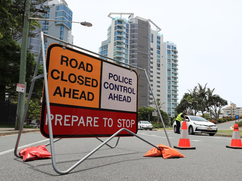 Queensland Police stop and check vehicles entering into Queensland at Griffith Street Coolangatta via NSW after Covid restrictions were re-instated. Photo Scott Powick Newscorp