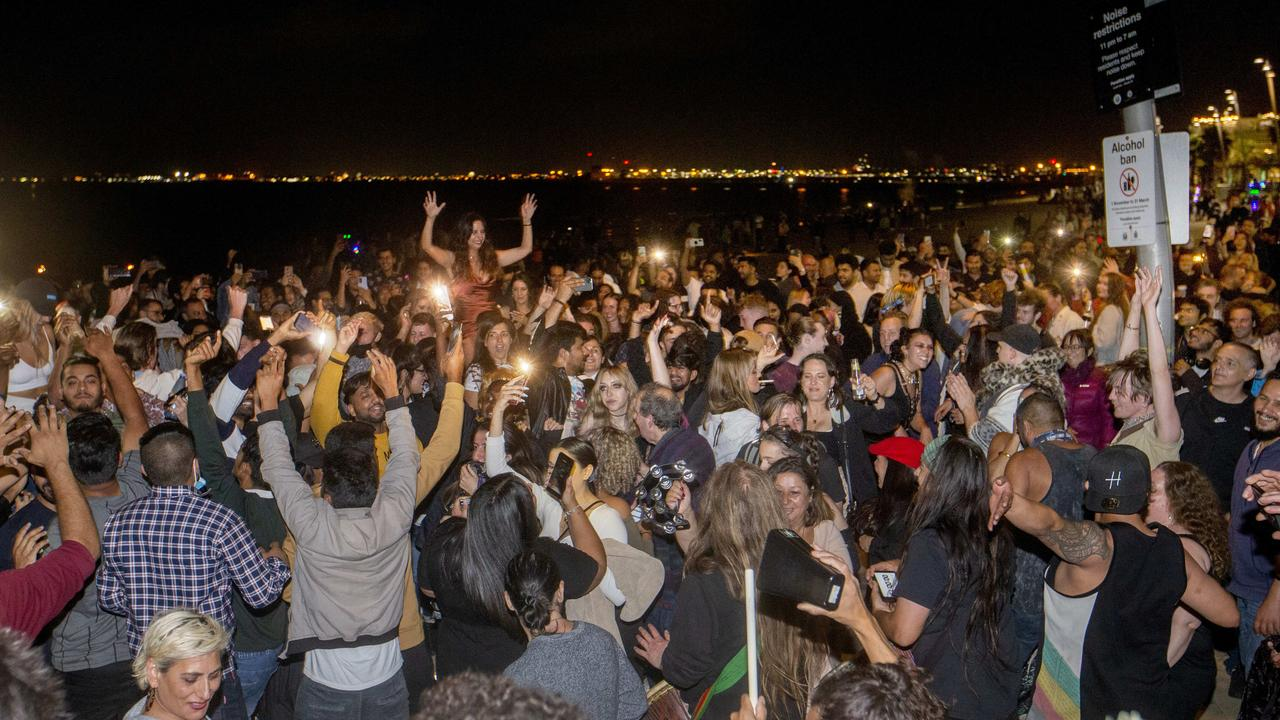 The scene on St Kilda beach at midnight. Picture: David Geraghty
