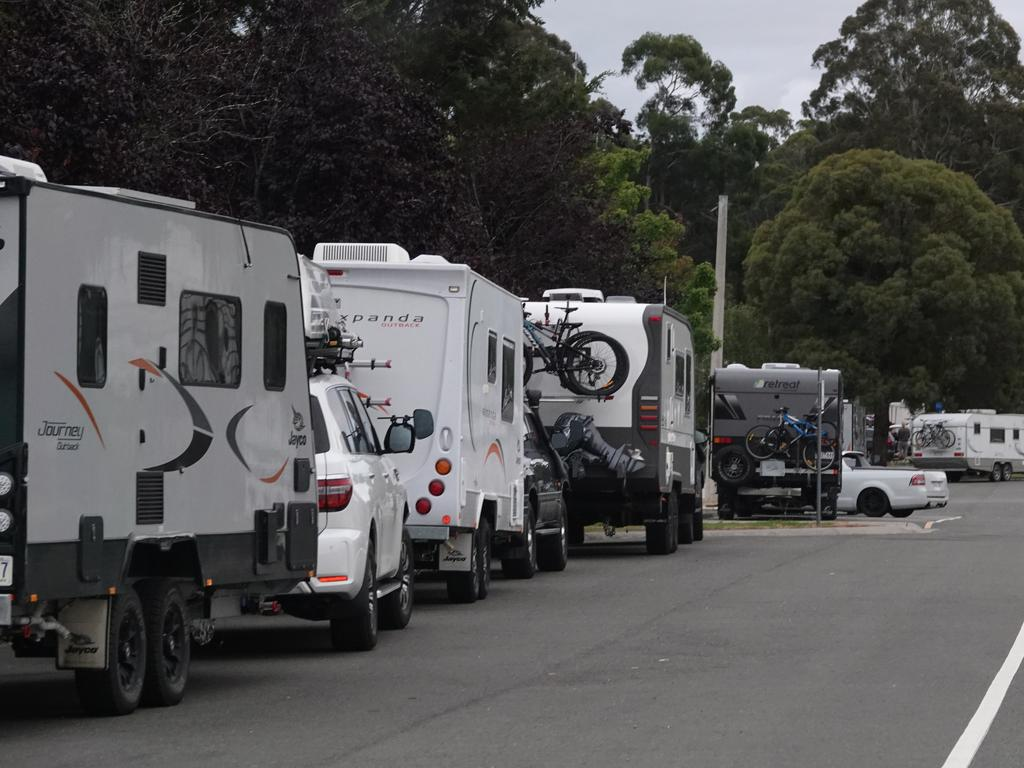 A mass exodus was created with holiday makers fleeing NSW and heading to the Victorian border in the confusion with the two different deadlines. Scores of people camping alongside the highway near Cann River in East Gippsland. Picture: Alex Coppel.