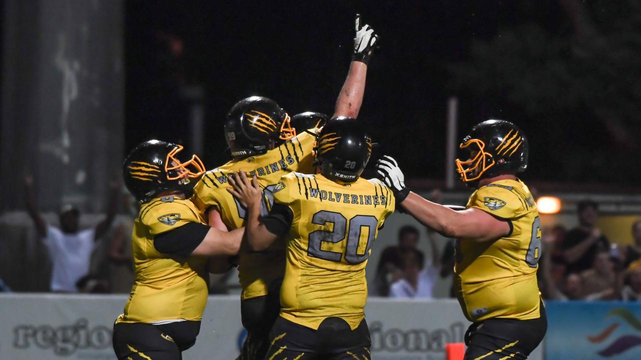 The Rockhampton Wolverines celebrate a touchdown in their grand final win. Photo: Allan Reinikka.