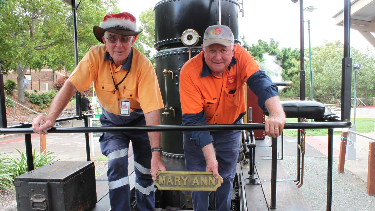 Whistlestop president Warren McPherson (left) and officer John Sim hold the original name plate where they intend to mount it on a piece of an old boiler from the Maryborough flour mill. A plaque will tell the story of the journey of the brass