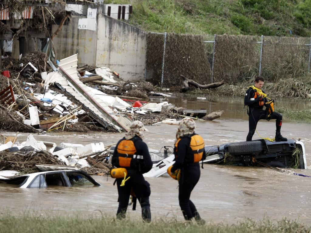 Disaster victim identification police scour the debris at Grantham.
