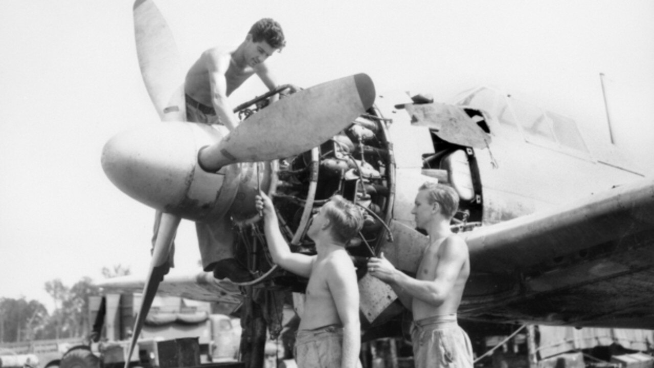 RAAF men overhauling the engine of a captured Japanese aircraft, a Mitsubishi A6M Navy Type 0 Fighter Aircraft, allied code name 'Zeke', at Morotai Island in the Halmahera Islands, Netherlands East Indies, May 17, 1945. They include Corporal Hugh Mitchell from Sarina, Leading Aircraftman Dick Ison from Brisbane and Corporal Roy Parker from Rockhampton. Picture: Australian War Memorial.