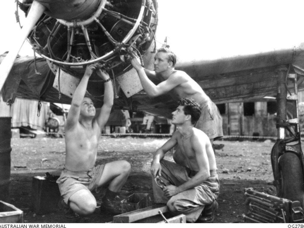 RAAF men overhauling the engine of a captured Japanese aircraft, a Mitsubishi A6M Navy Type 0 Fighter Aircraft, allied code name 'Zeke', at Morotai Island in the Halmahera Islands, Netherlands East Indies, May 17, 1945. They include Corporal Hugh Mitchell from Sarina (believed to be centre in the photograph), Leading Aircraftman Dick Ison from Brisbane and Corporal Roy Parker from Rockhampton. Pi